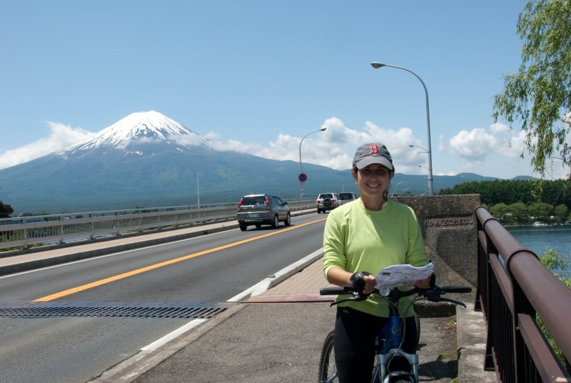 Mt. Fuji, Elizabeth biking with Mt Fuji in bkgrd