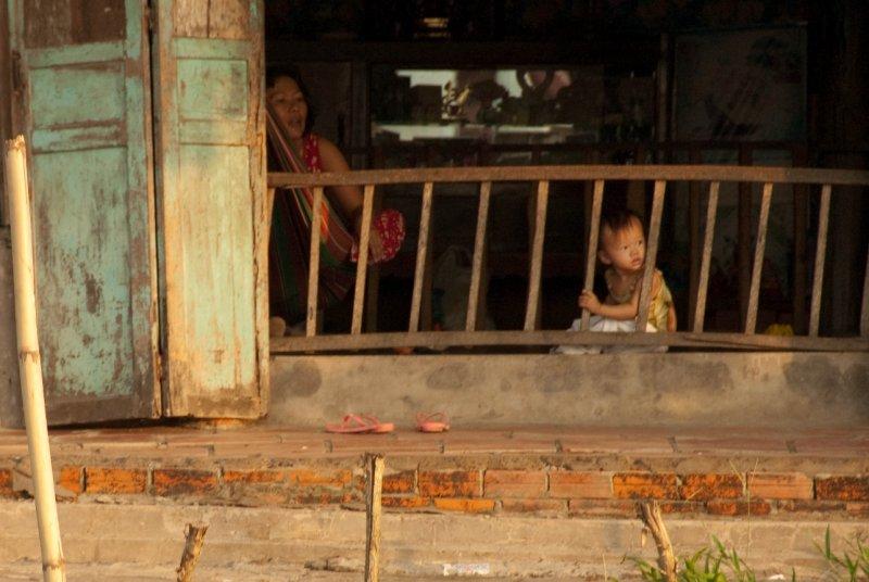MD Mekong Delta, boy behind railing
