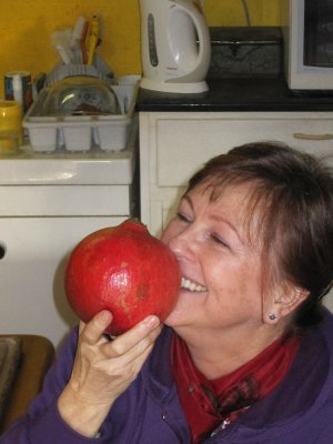 Sandi relishing the thought of eating her huge pomegranate - a New Year's treat bought at a Venetian foodstall