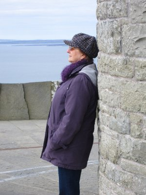 Sandi in reflection, with the Aran islands in the background
