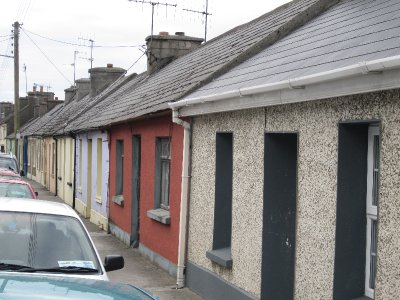 These humble terraces were built before the Celtic Tiger boom and have very small rooms inside. Note the pebble-dash finish which is very popular in Ireland