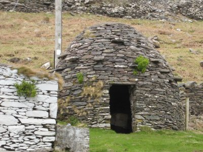 "Old ""beehive hut"" which was inhabited 4000 years ago. The stones were laid sloping outwards so the rain would run off"