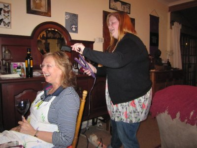 Rebecca demonstrating her hair straightening tool