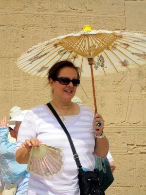 Sahar, with her heat-beating equipment; a fan and a parasol.