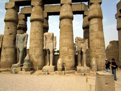 The Court is surrounded by statues of Ramses lll.