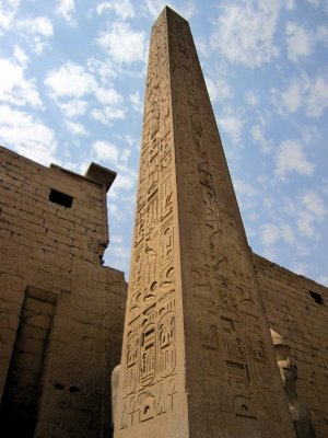 Ramses ll placed two red granite obelisks at the entrance.  They were given to France in 1830, but as they weighed 250 tons each, only one was transported and now stands on Place de la Concorde, and the other one remains here at Luxor.