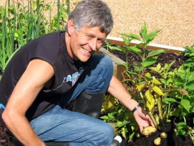 Gardener Dave, fondling the produce!