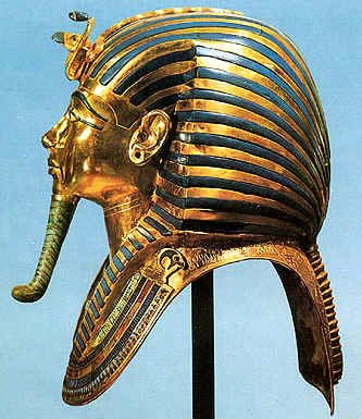 """The iconic burial mask from the side, showing a false """"beard"""".  Egyptian men were clean-shaven, and beards were sacred to the gods.  Pharaohs were endowed with a beard to signify god-like qualities."""