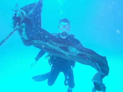 Curt with underwater flag