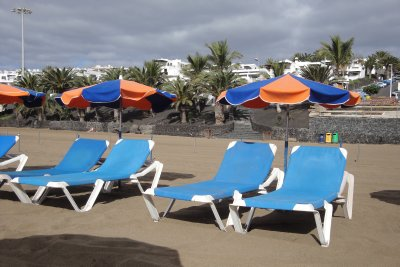 beach chairs with lava border in background