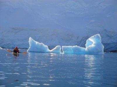kayakying around iceberg