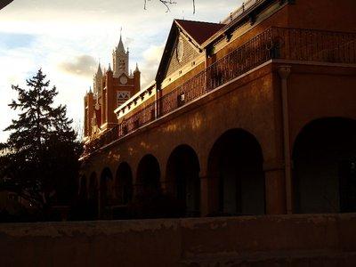 sun setting on chapel