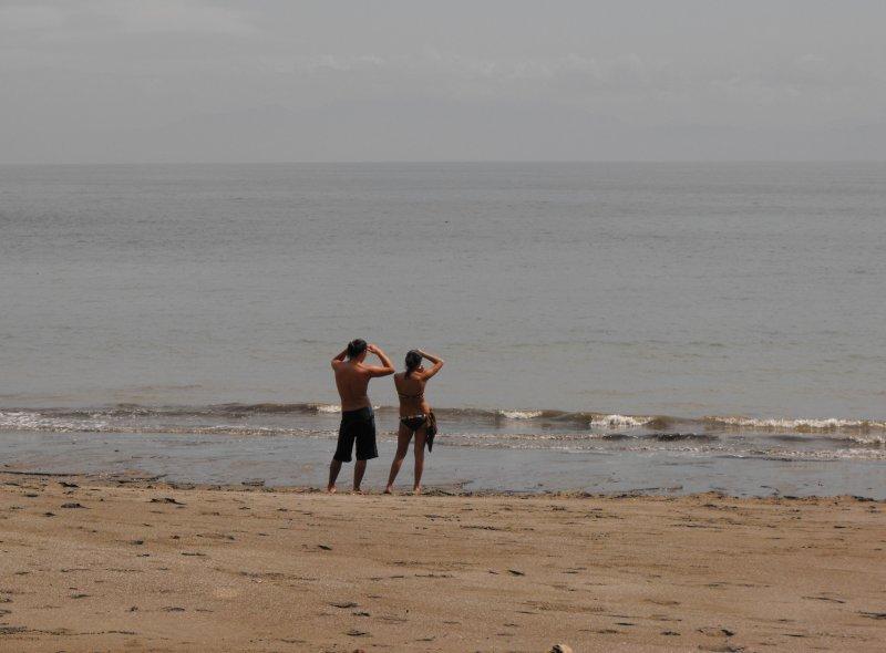 MONTEZUMA couple leaning on beach
