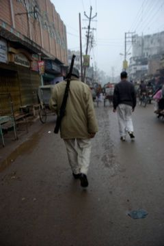 corrupt policeman on streets of varanasi india
