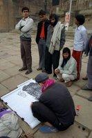 guy painting at varanasi