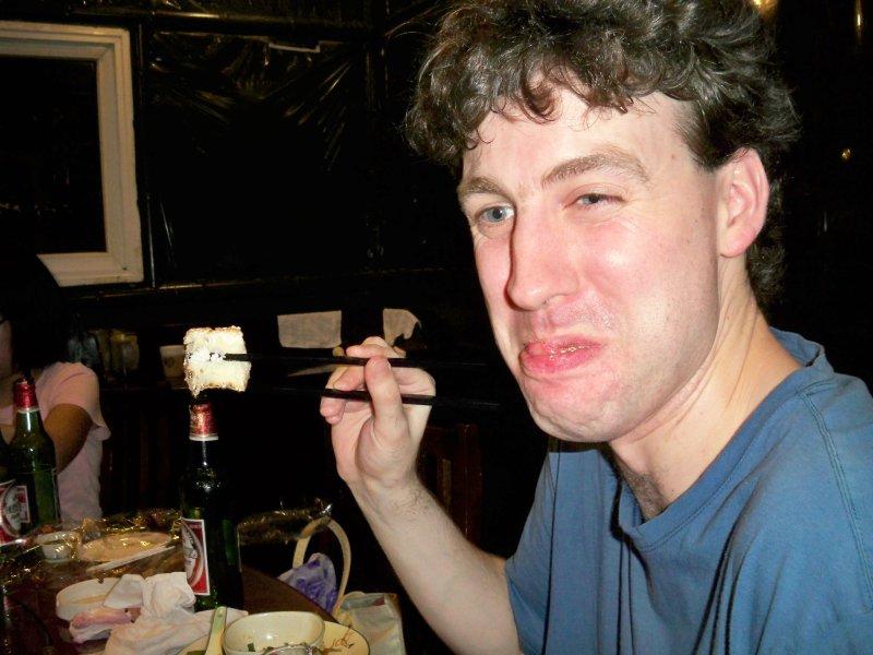 Bill enjoys birthday cake - with chopsticks!