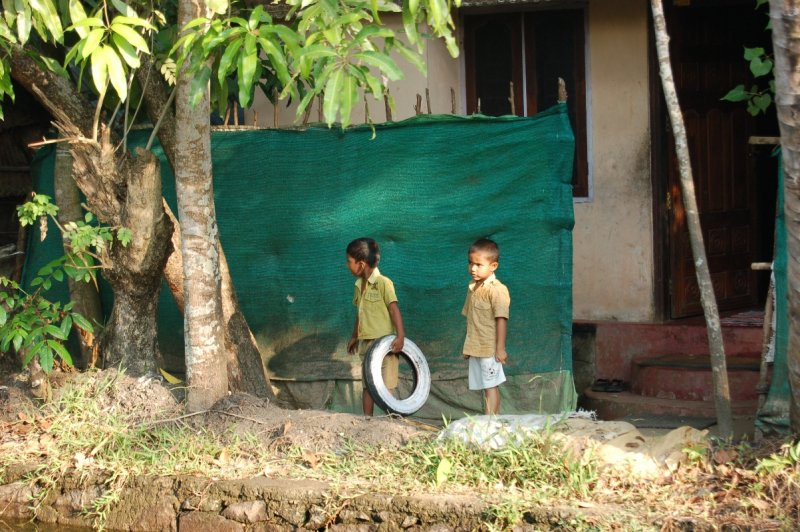 Kids at edge of backwaters
