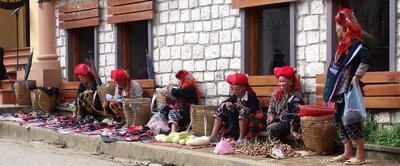 Red Hmong tribal ladies sell their wares