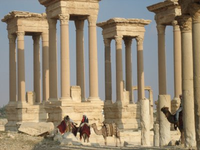 Camel riders at the Tetrapylon