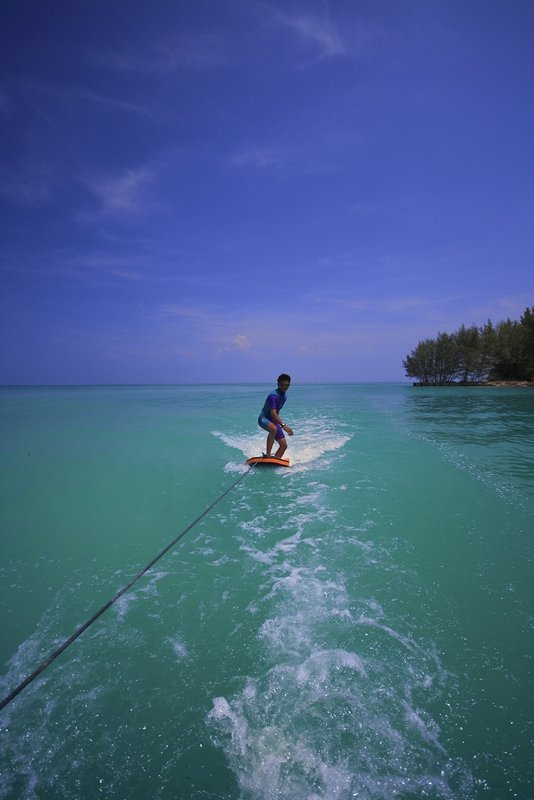 Boat surfing in One Thousand Island, North Jakarta, Indonesia