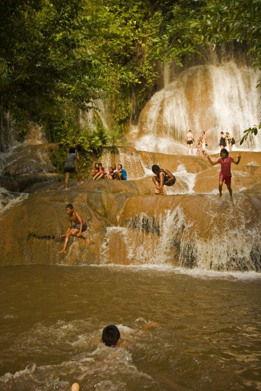 Kids jumping waterfall