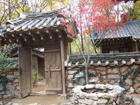 Well, gate, and autumn leaves--South Korea
