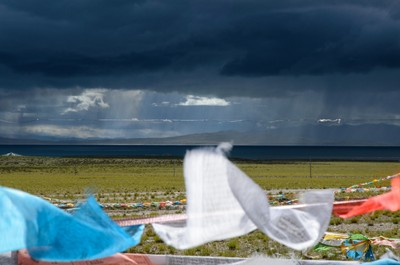 Prayer flags in front of heavy clouds
