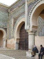 Women sitting outside the Bab el-Mansour Gate
