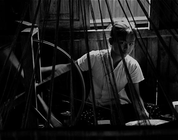 A girl weaving