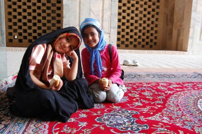 Two girls chilling out at a mosque