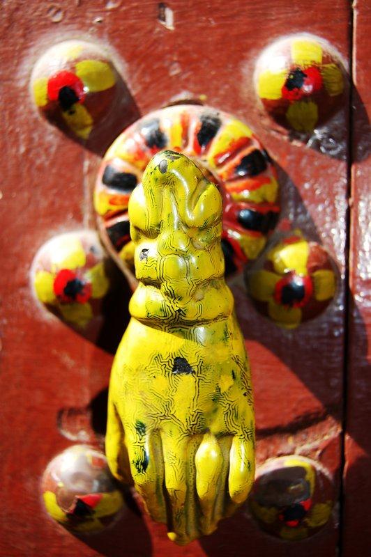 Yellow doorknocker