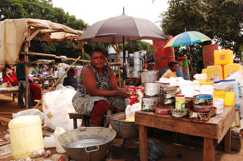 Woman selling empty canisters
