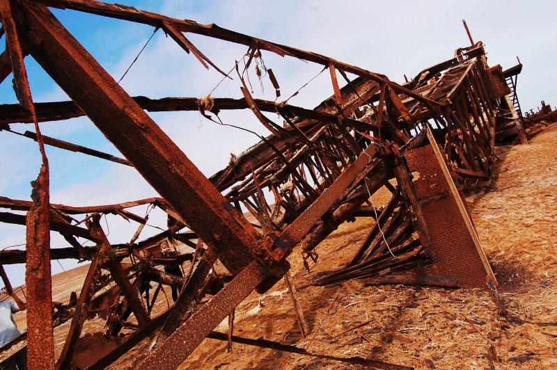 Abandoned oil rig in the desert