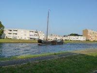 An old freight boat motoring along the Korte Vliet waterway, between Voorschoten and Leiden