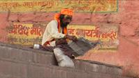 guru reading newspaper in Benares Varanasi
