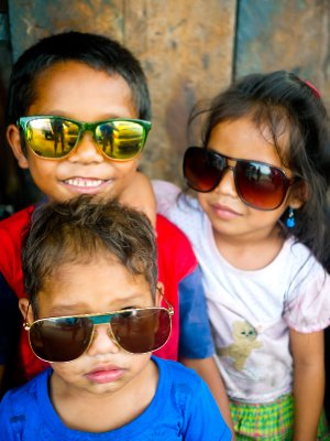 Street children with sunglasses