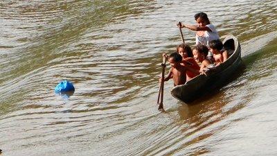 Amazonian children getting free clothing, Ilha de Marajó