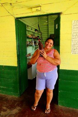 Dona Angela and a bottle filled with açaí, Curiaú
