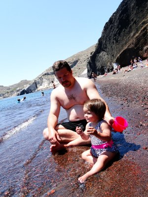 Playing in Red Beach, Santorini