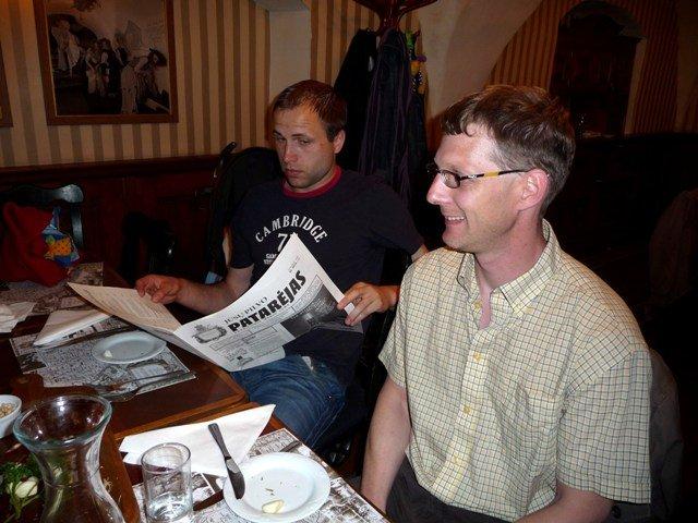 Reading the menu at Lokys, Vilnius