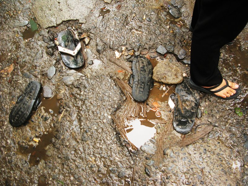 Old flip flops fill potholes