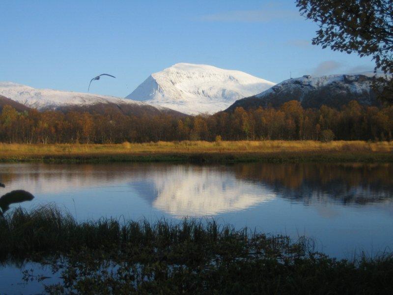 Seasons Clash on Tromsdalstinden