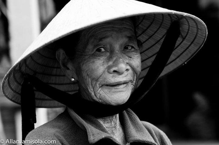 Elderly Woman behind a counter