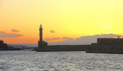 Lighthouse on outer wall at sunset