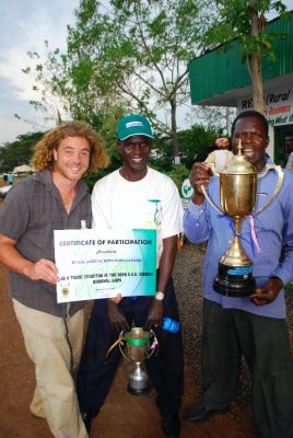 Me (the white one), Sam and George displaying 1 of the REAP (Rural Africas with Peoples Poor - obviously) trophies