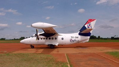 An Eagle Air flight on the red-earth airstrip