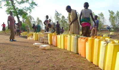 A long line of jerry cans waiting for the borehole.