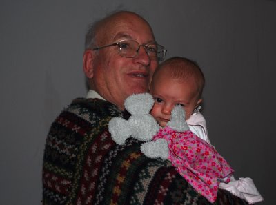 Grandpa cuddles Amelie who loves patterned jumpers