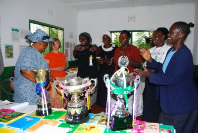Dancing and celebrating around REAPs trophies
