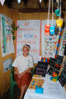 Mama Em relaxes in her colourful school resources stall